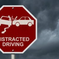 A-distracted-driving-stop-sign--540x325