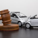 Car accident between two miniature cars behind gavel